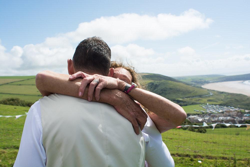 groom and his mum have a huge hug at woolacombe wedding