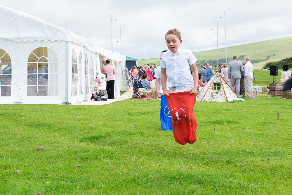 sack races at festival wedding in woolacombe