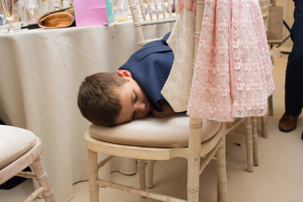 little boy crashed out on chair at woolacombe wedding