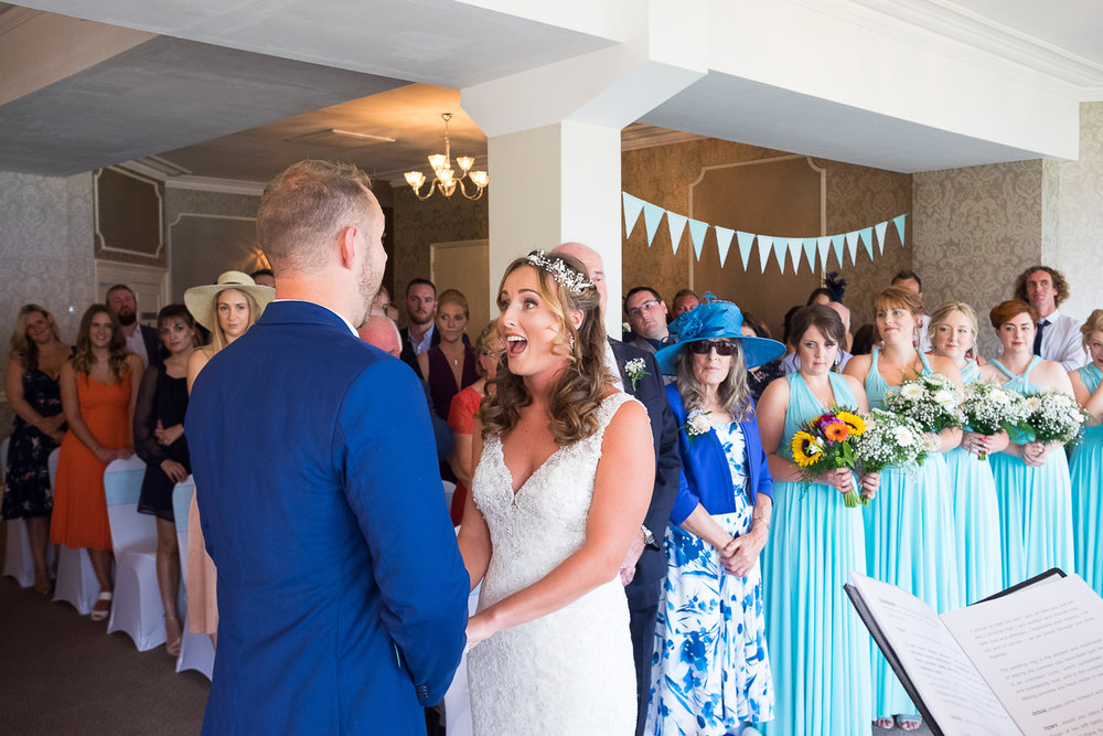 Bride's excited face at their wedding ceremony at the St Ives Harbour Hotel in Cornwall