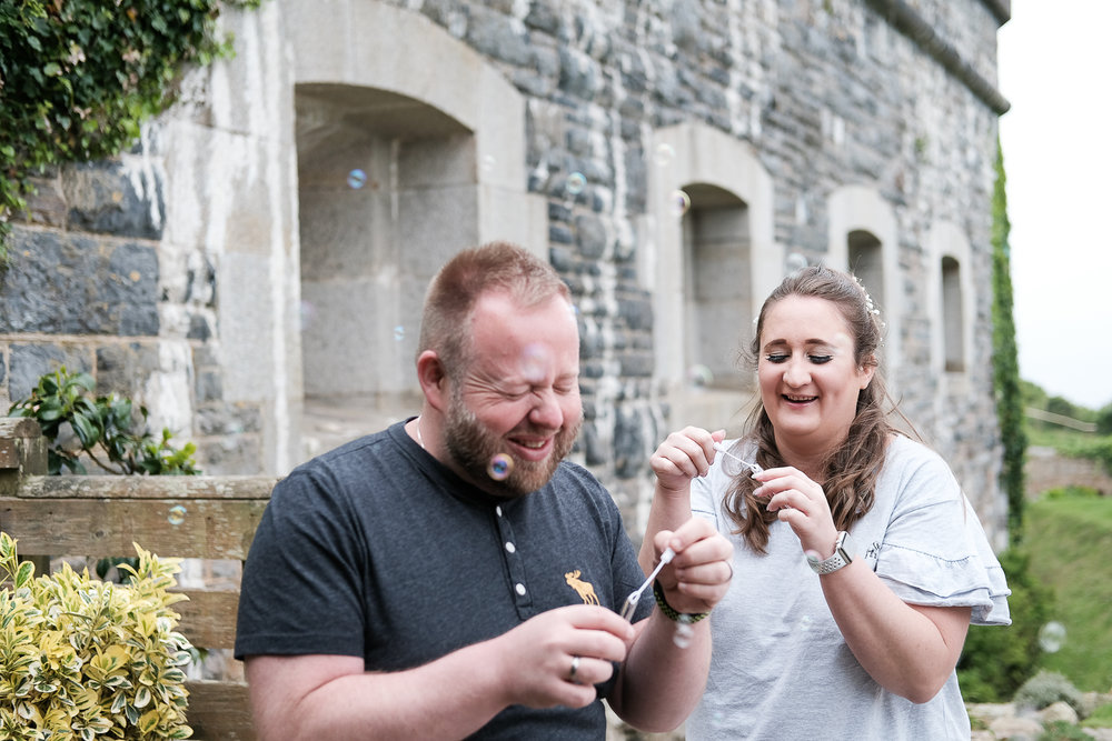 Spending time together outside the Fort, blowing bubbles in each others faces before the ceremony.