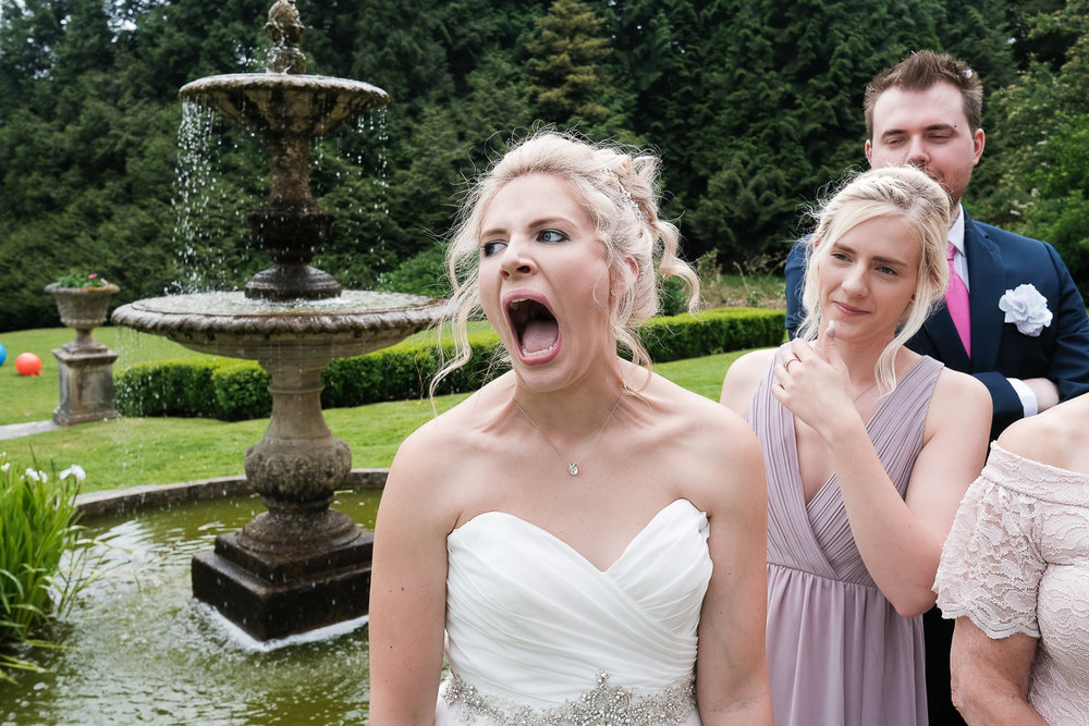 bride with achy face after smiling for too many group photos