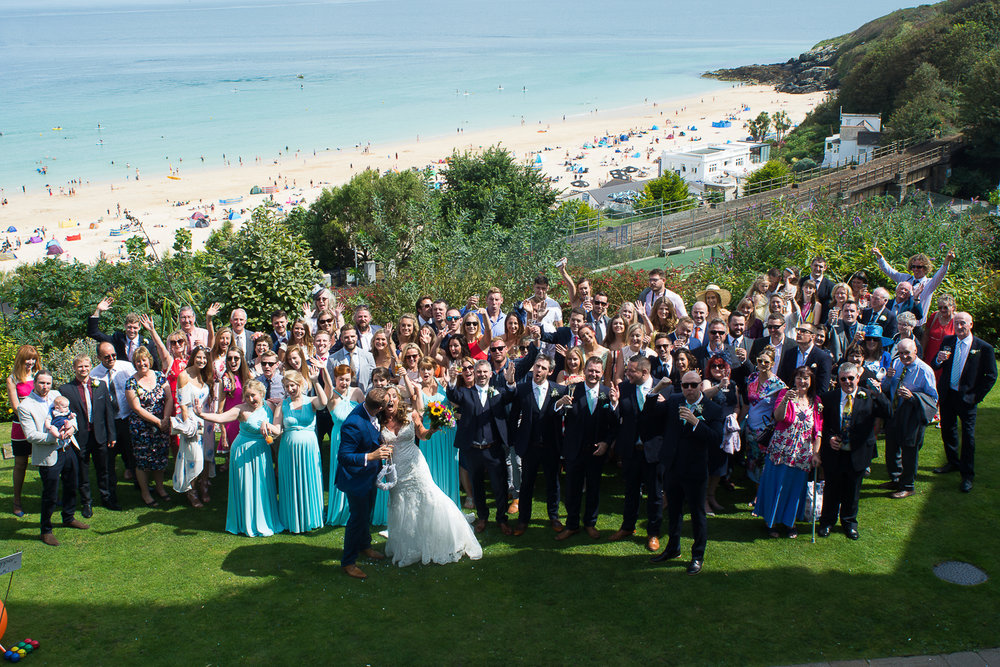 Group photo of all guests at Laura and Tony's St Ives Harbour Hotel wedding