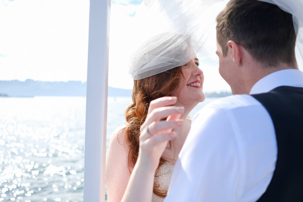 bride and groom on a boat ride at their plymouth wedding