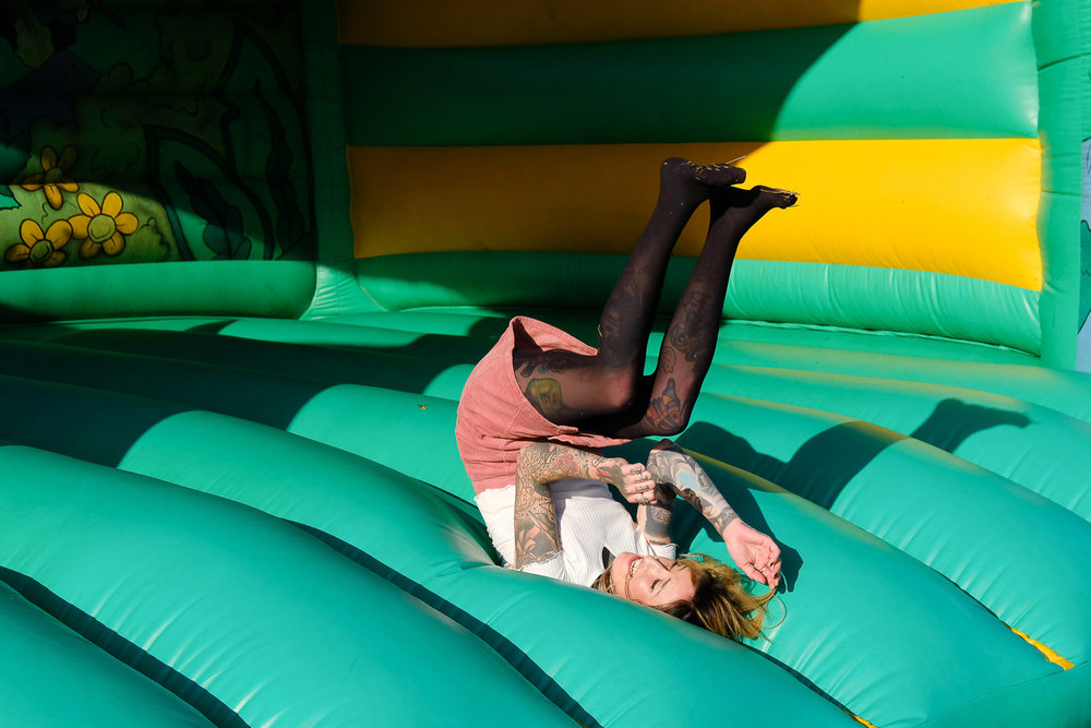 bouncy castle front flips at festival wedding in exmouth