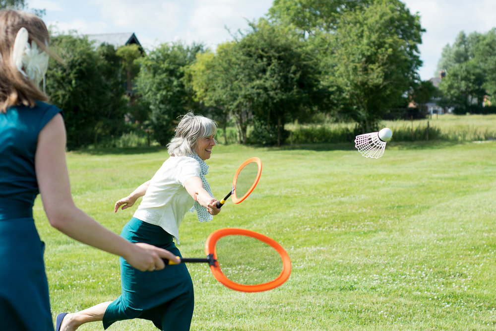 Game of badminton at festival themed wedding