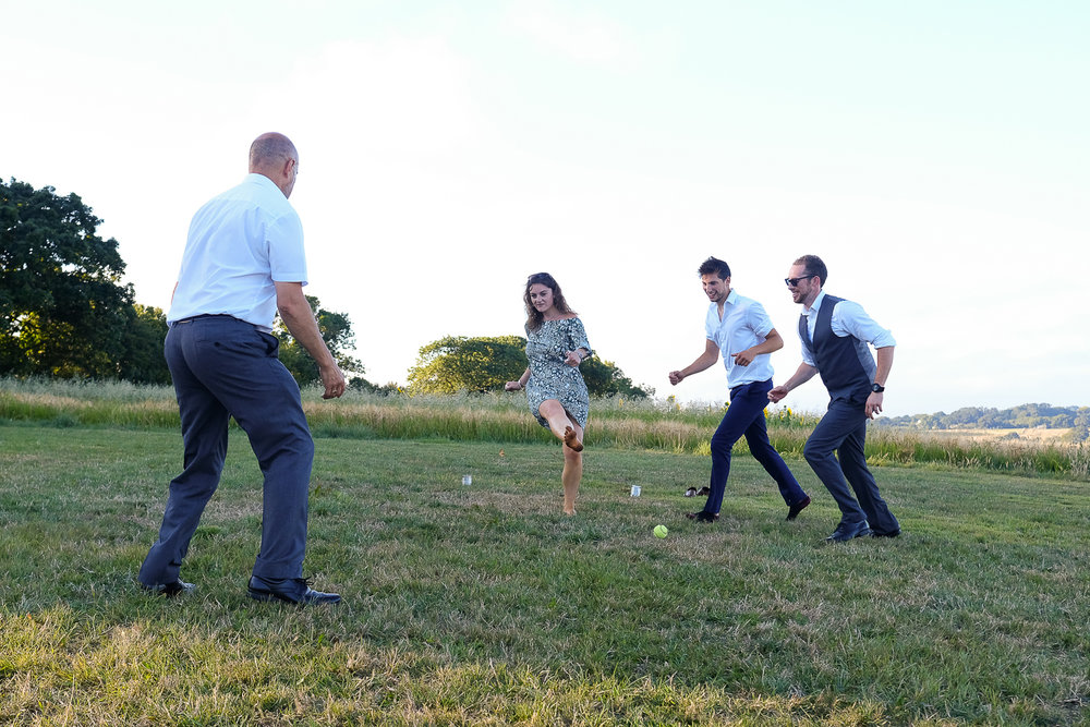 little game of football at Festival style wedding in Cornwall