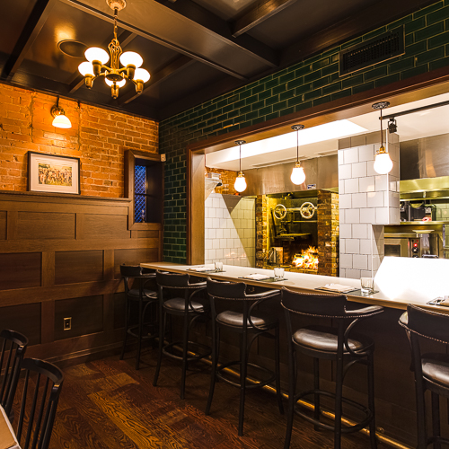 Interior design, setting, ambiance, environment and atmosphere at the restaurant Maple Leaf Tavern in Toronto