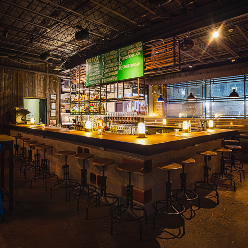 Interior design, setting, ambiance, environment and atmosphere at the bar and restaurant Mascot Brewery in Toronto