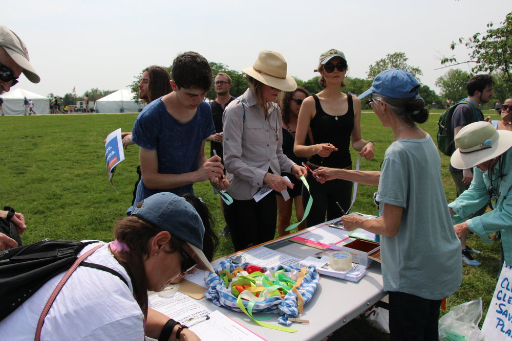 Marchers shared their own stories at our ribbon-making table.