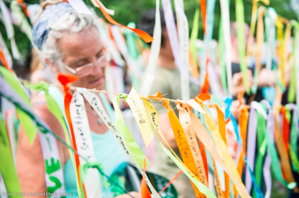 Ribbons fluttering in the wind, stories traveling the globe. Photo from the official  People's Climate March album
