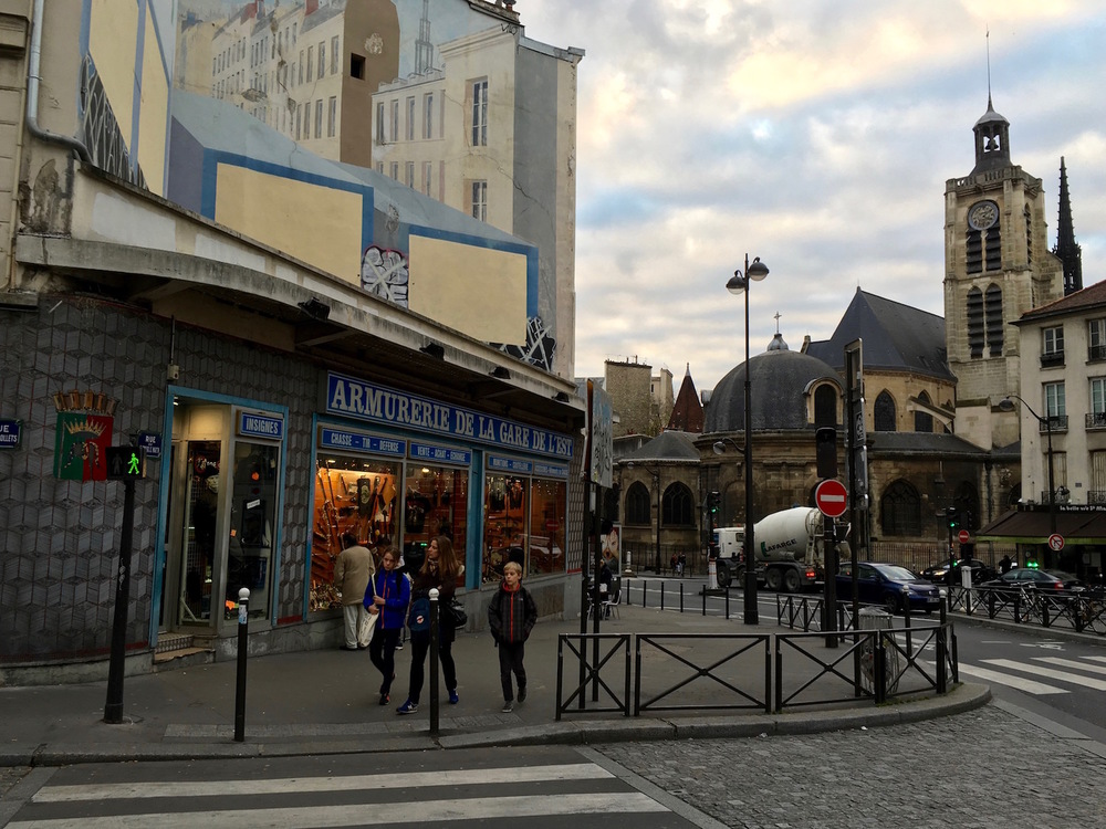 Another view of the weapons store against a Parisian backdrop.