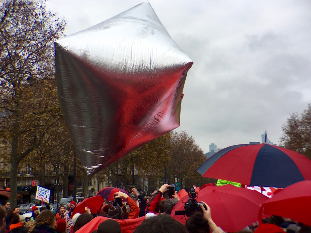 On Sunday, December 13, as the Delegates finished the final agreement, thousands of people took to the streets all over Paris in celebration and protest. This photo was taken near the Arc de Triomphe on the Avenue de la Grande Armee.