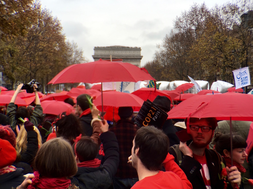 Red umbrellas as a symbol of continued resistance.