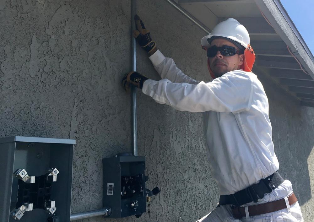 The amazing Keaton McGuire, GRID Solar Installation Supervisor (SIS) running an install in San Bernardino.