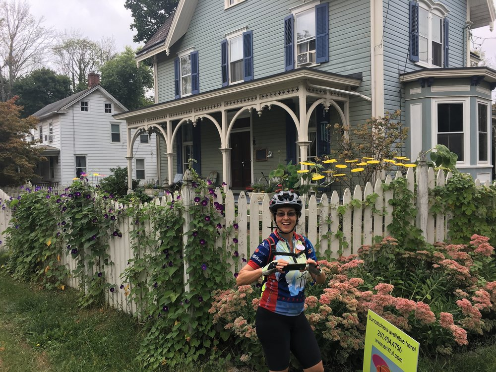 Susan Benesch in front of a classic PA home