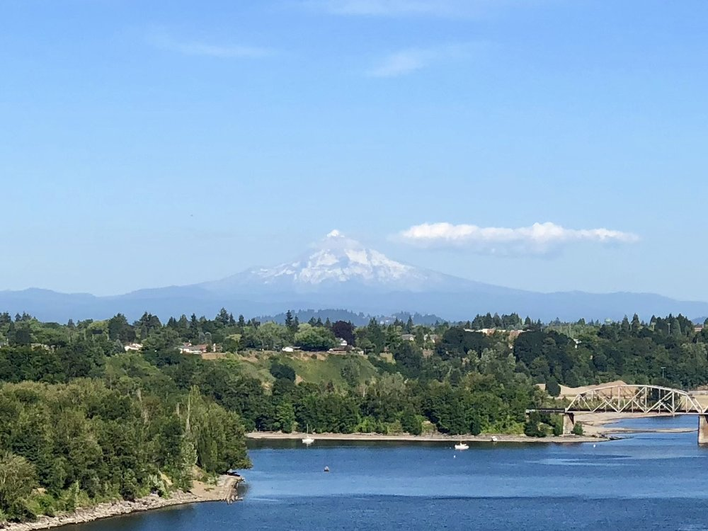 Mt. Hood looms in the distance off the Saint John's bridge across the Willamette River.