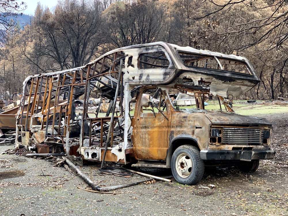 A large burnt out camper van sits by a highway near Delta, Ca. The Woolsey and the Delta fires took place in September and November, 2018, respectively.