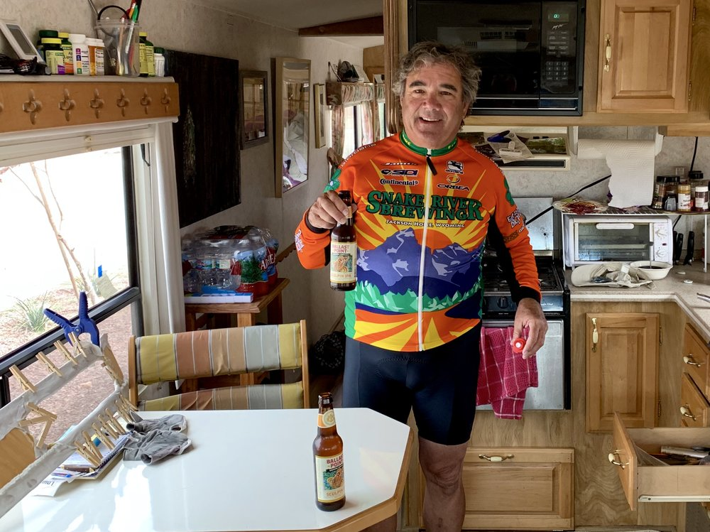 Dave in his RV offering me a beer after a very windy ride.