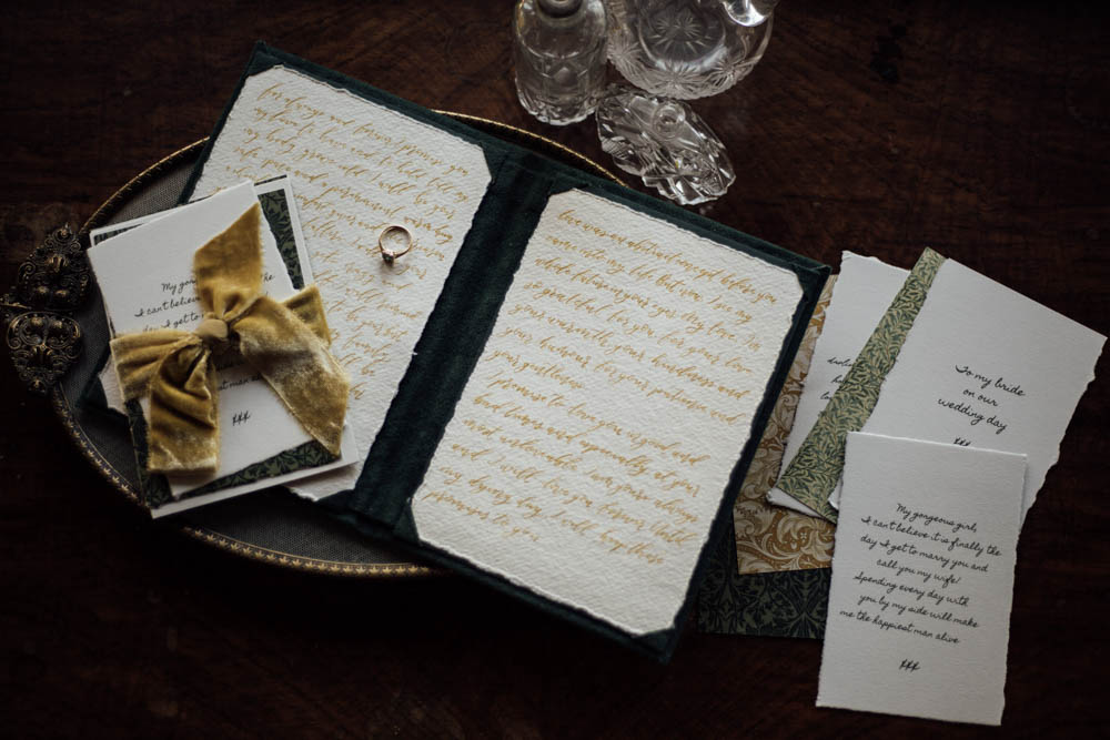 Handwritten calligraphy vows in velvet vow book