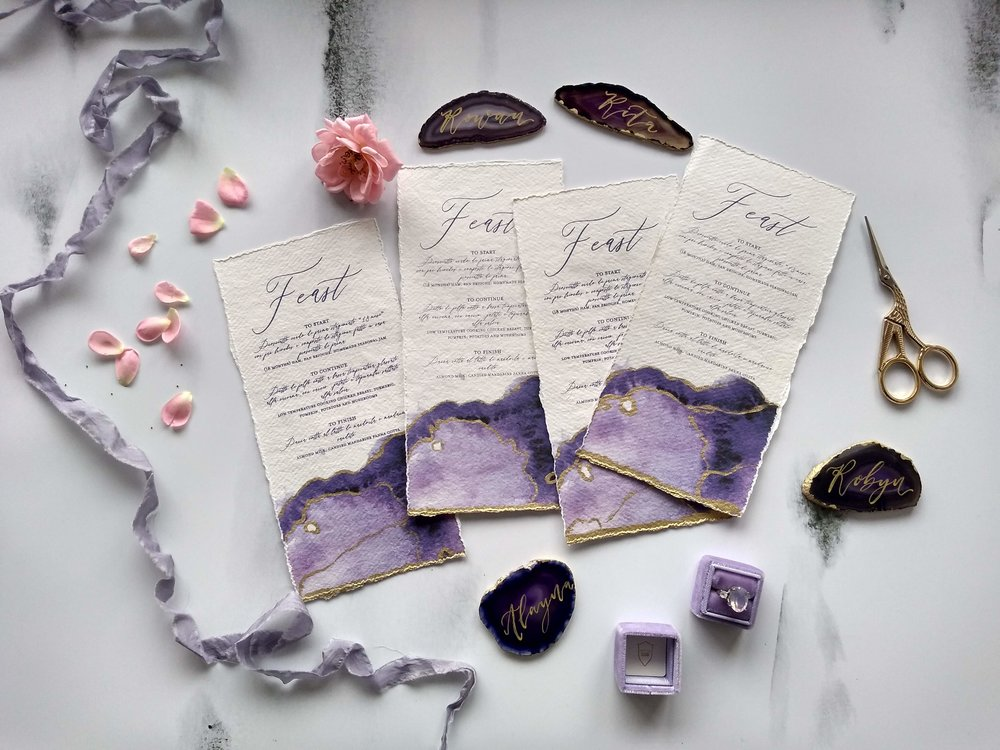 Modern calligraphy and gold leaf menus on handmade paper