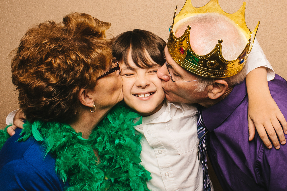 A family at a party in the Vert Booth, an open air photobooth in Denver, Colorado