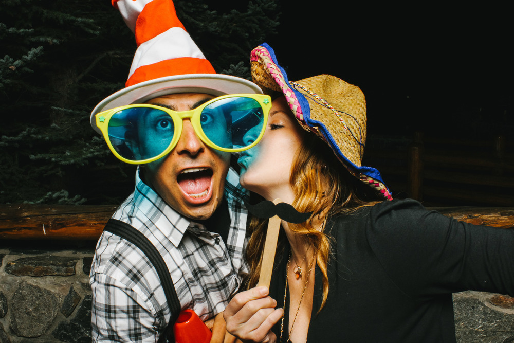 Two friends and some wild props in the Vert Booth, an open air photobooth in Denver, Colorado