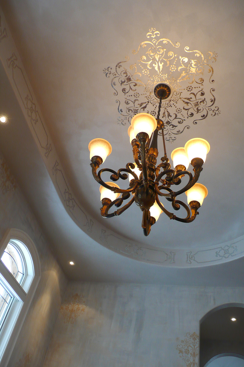 This ceiling medallion was done in imitation silver leaf and makes a very special and unique addition to this dining room.