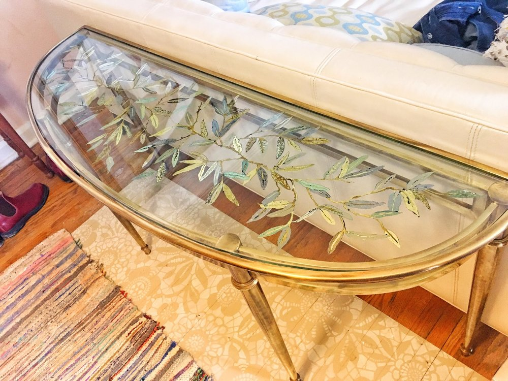 Verre eglomisé table top with multiple shades of gold leaf, german glass crystals and polychromes.