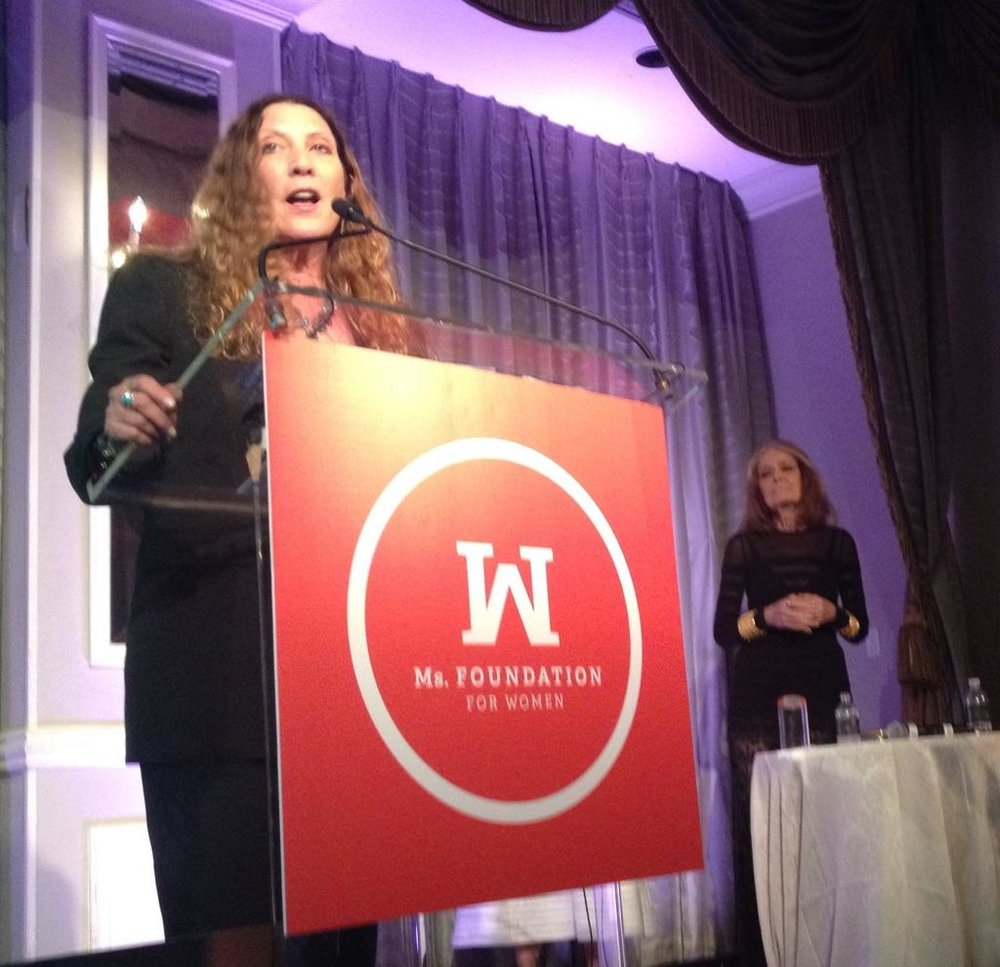 Client Suzanne Lerner, CEO of Michael Stars, accepting Gloria Award from Ms Foundation's Gloria Steinem.