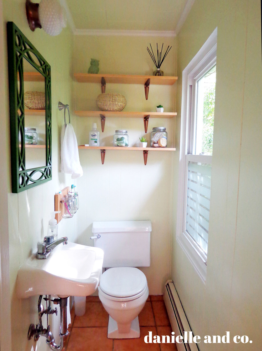 Small bathroom updated with Dark Linen by Benjamin Moore, and DIY shelving! All for just around $200.