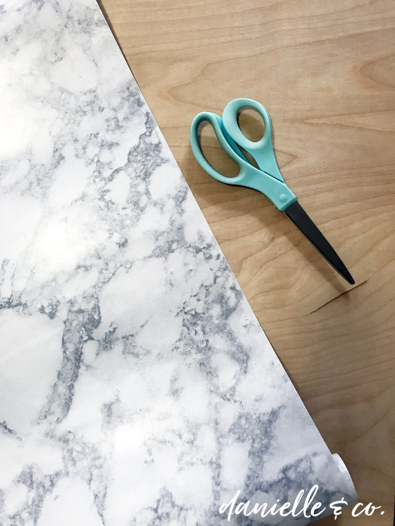 How to DIY a Marble-Look Photo Backdrop to showcase your artwork, crafts, and other projects. Supply list and instructions on danielleandco.com