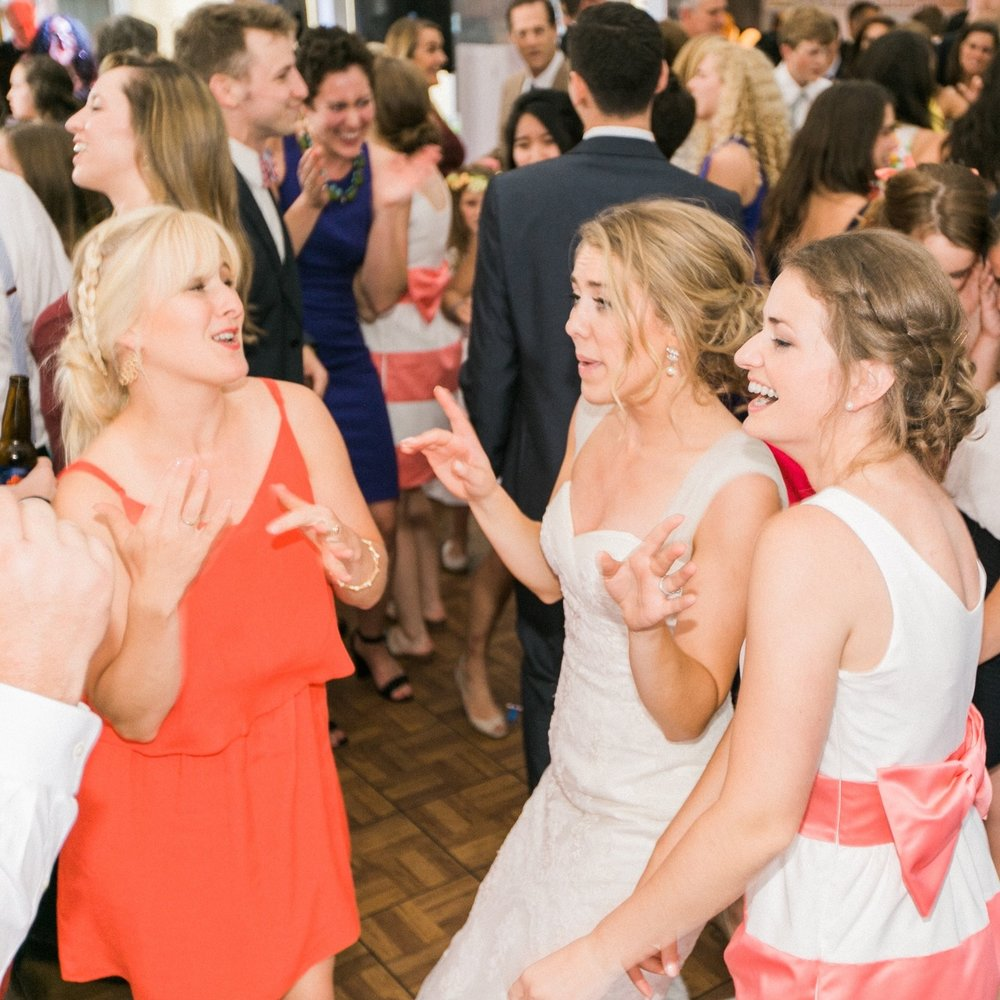 Emily, left, and Caroline, right, dancing with me at my wedding. Don't let their looks fool you—they are actually sisters!