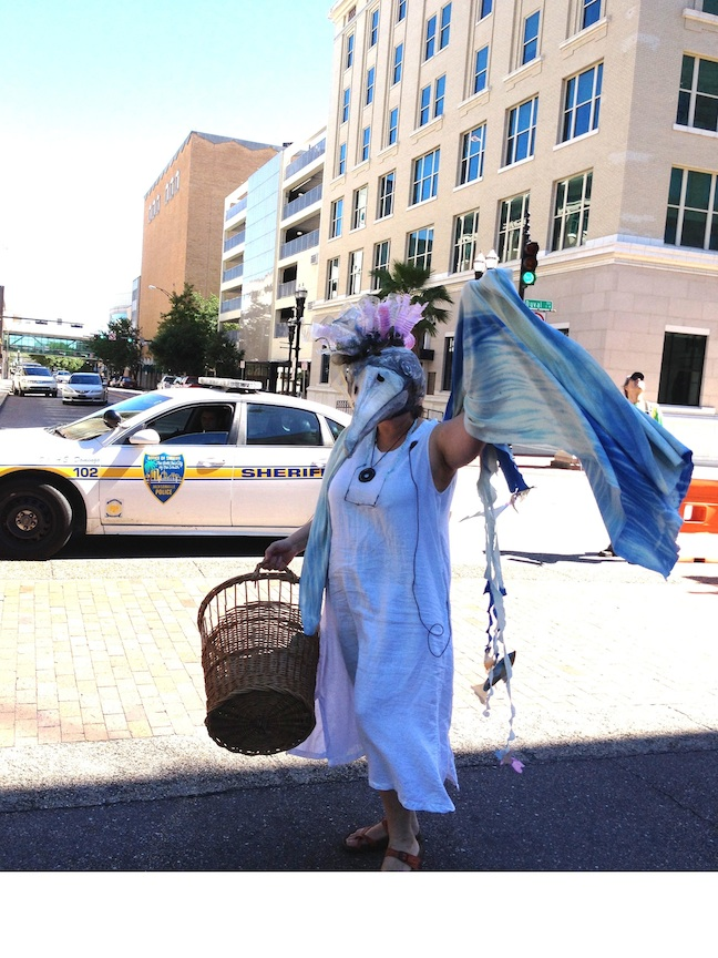 A character in Waterspirit Rises, the endangered Wood Stork of Red Pearl River, waves in Hemming Park downtown Jacksonville. Image courtesy of Judi Herring 2014