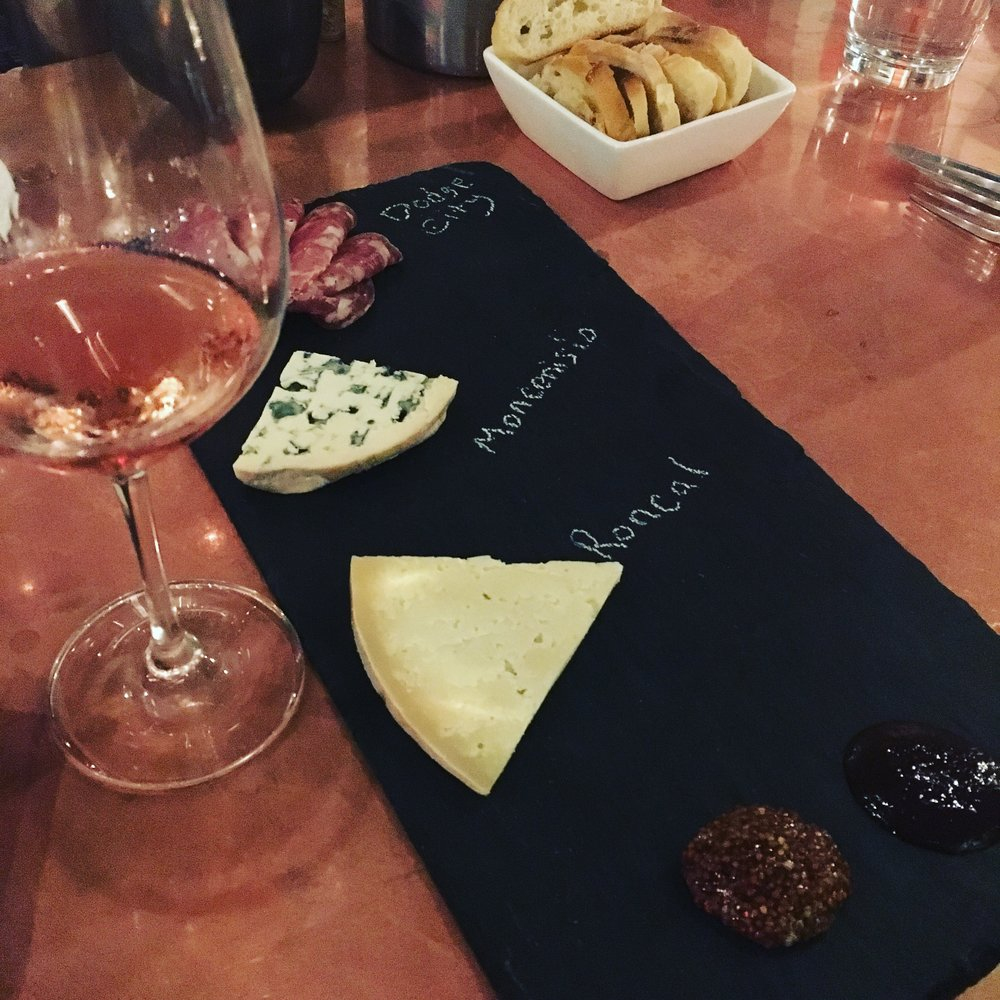 Secco Wine bar - A tasty charcuterie board with some vino, duh