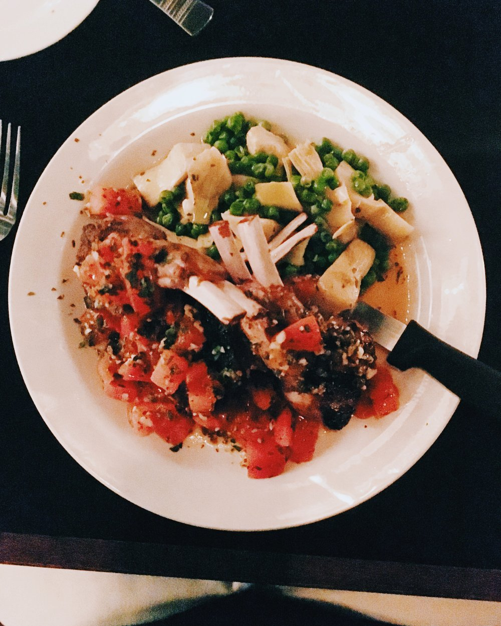 Demi's - Lamb chops with fresh tomatoes, garlic, herbs served w/ peas and artichokes.