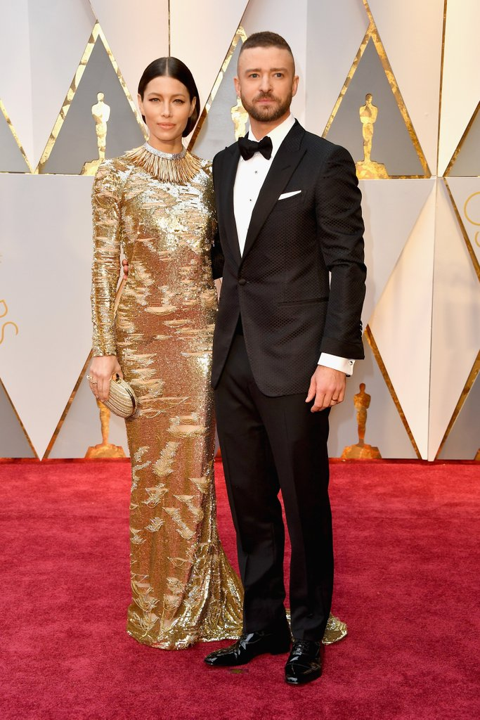"""Jessica Beil in an incredible golden gown  - today.com describes Biel in this dress as """"royalty""""."""