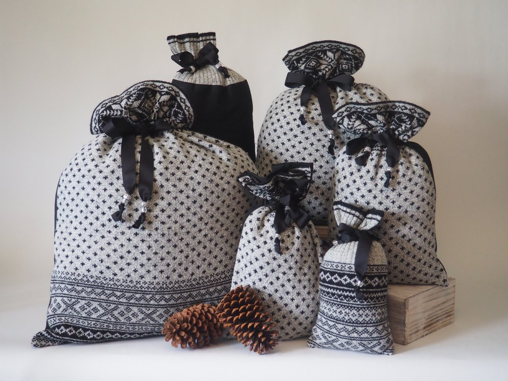 These bags are made with an old sweater. Do you have a memorable piece of clothing you would love to repurpose? Send us an email!
