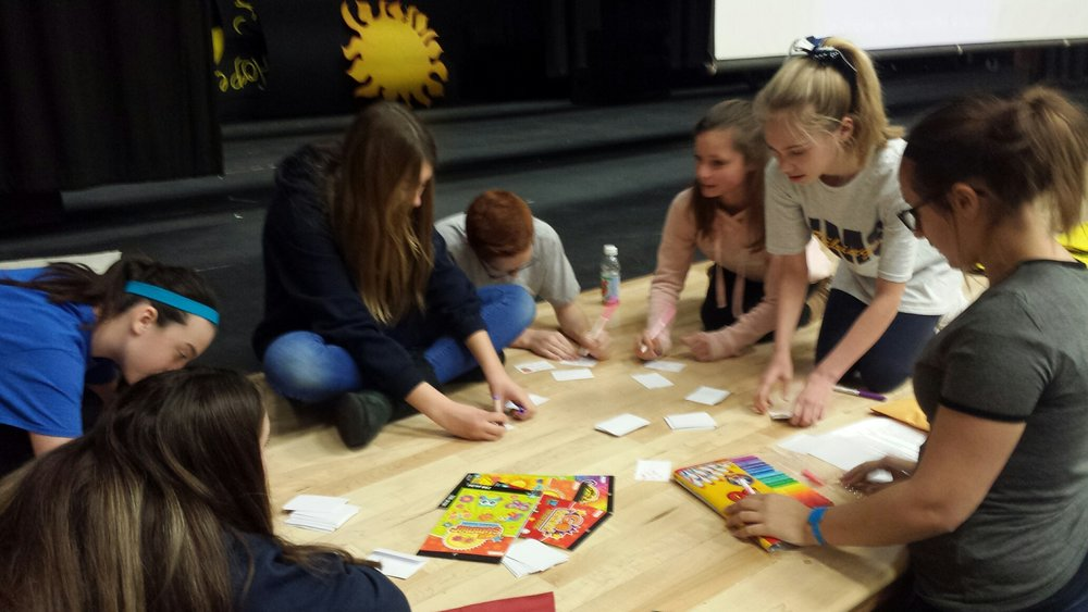 Northley Middle School 7th graders making cards to put into the Smile Bags.