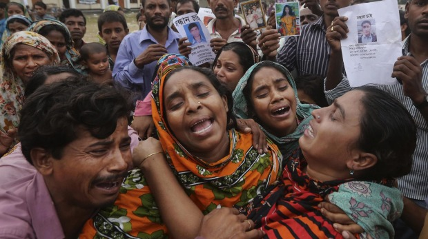 Relatives of Mohammed Abdullah, garment worker in Rana Plaza, cry as they as they arrive to collect his body near Dhaka, Bangladesh. Photo: AP