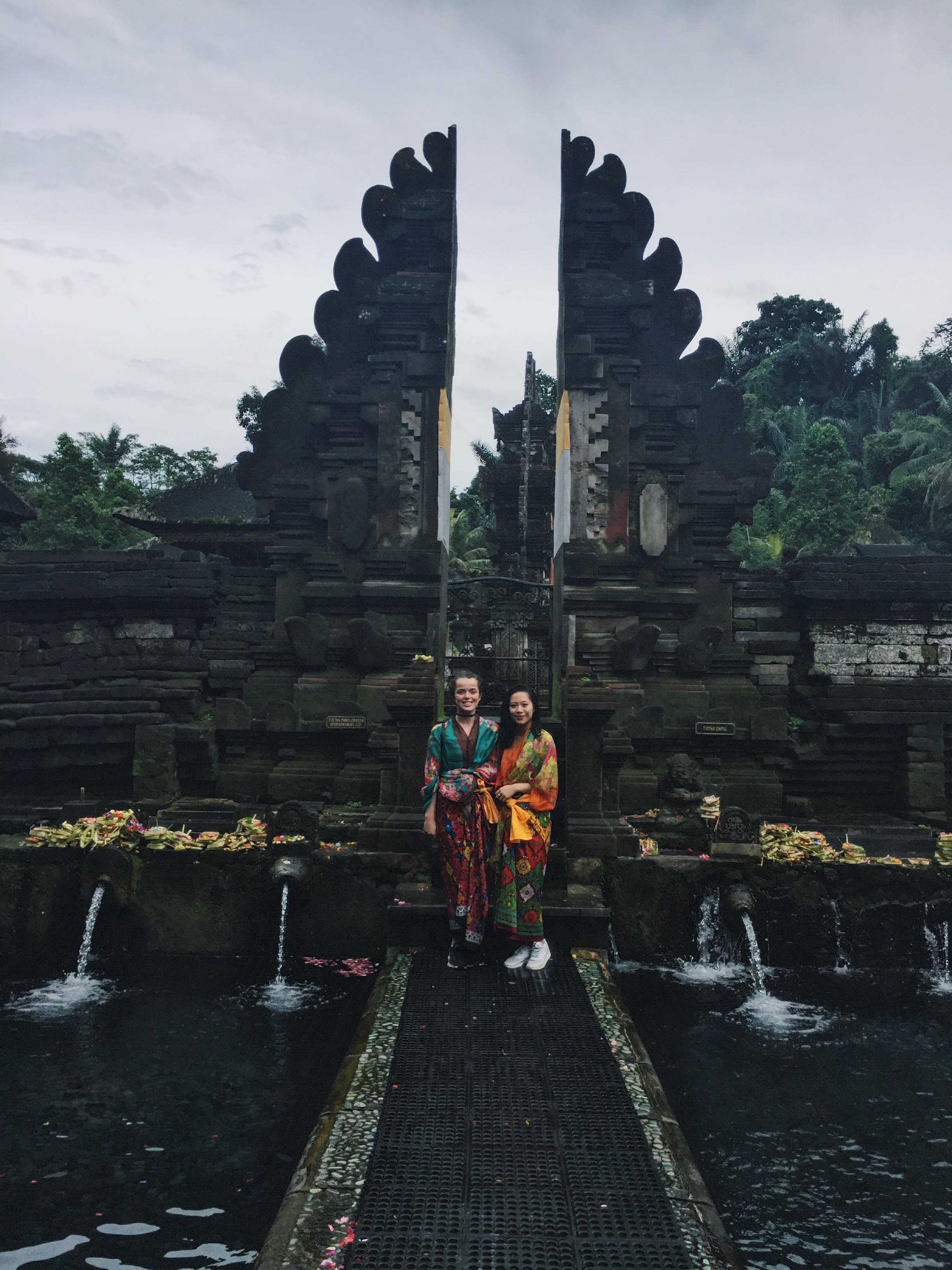 Ashley and I at Pura Tirtha Empul in our stylish sarongs provided at the temple gates.