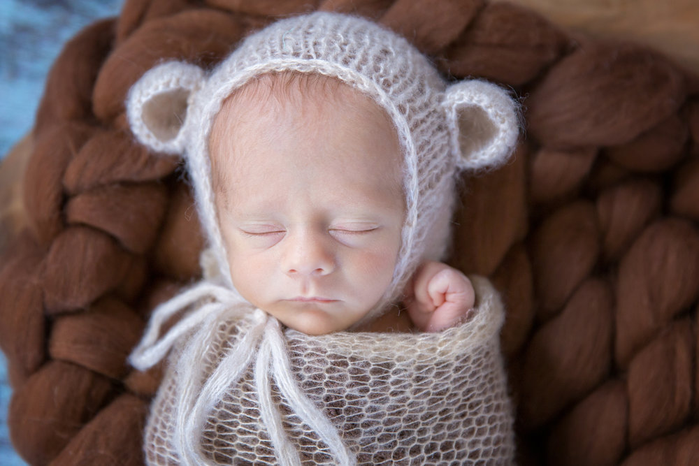 Baby boy in a bear hat. Newborn photoshoot in Calgary Alberta.