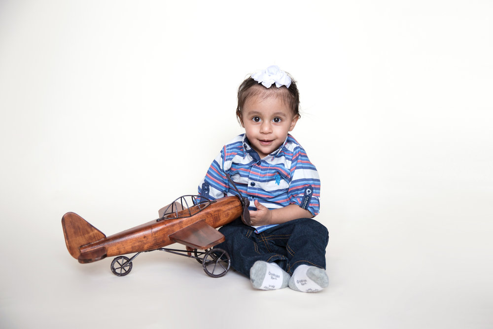 Baby Boy's 1st Year milestone photoshoot with an airplane