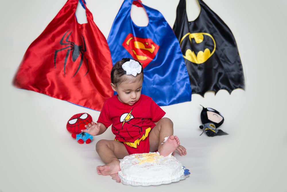 Foot in a cake. Baby boy's 1st Birthday. Superhero Cakesmash. Airdrie Photographer. Calgary Photographer