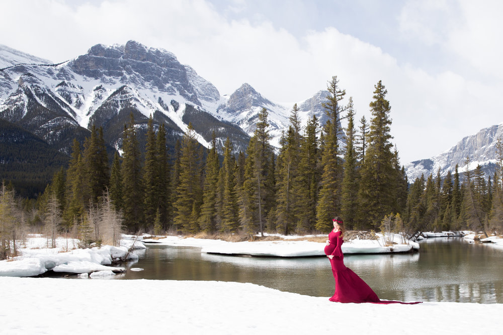Mom to be in a beautiful red gown. Kananaskis maternity photoshoot. Calgary Photographer.