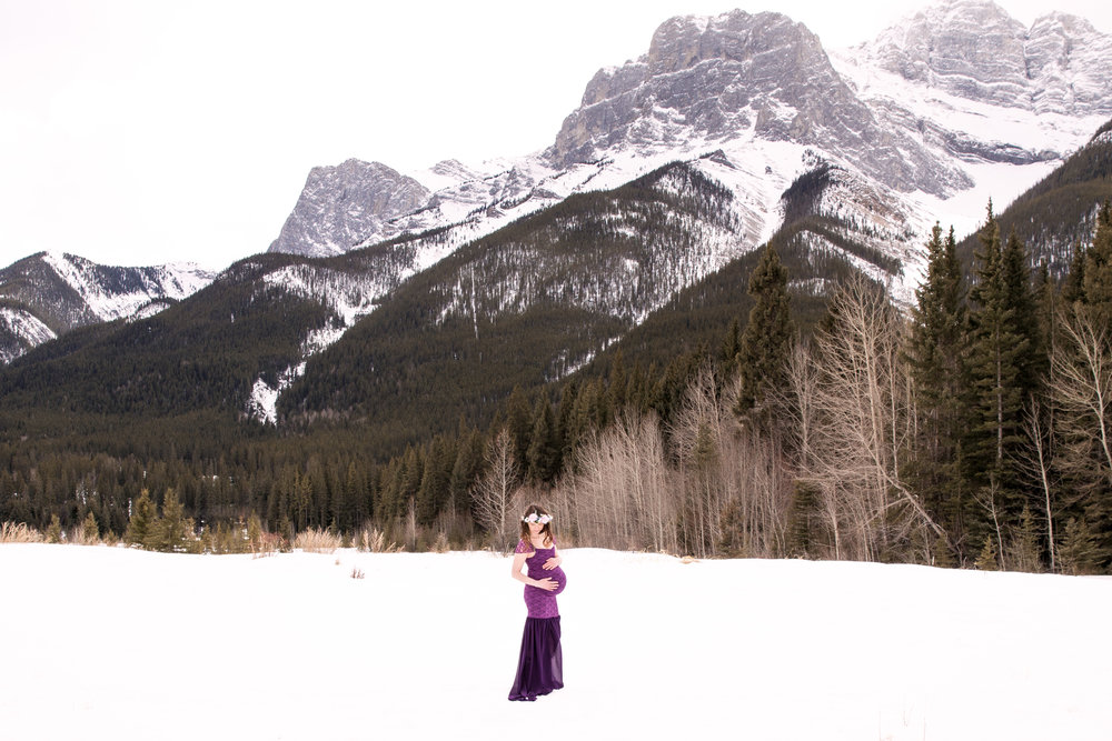 Mom to be in a purple gown. Winter Maternity Photoshoot. Calgary and Airdrie photographer.