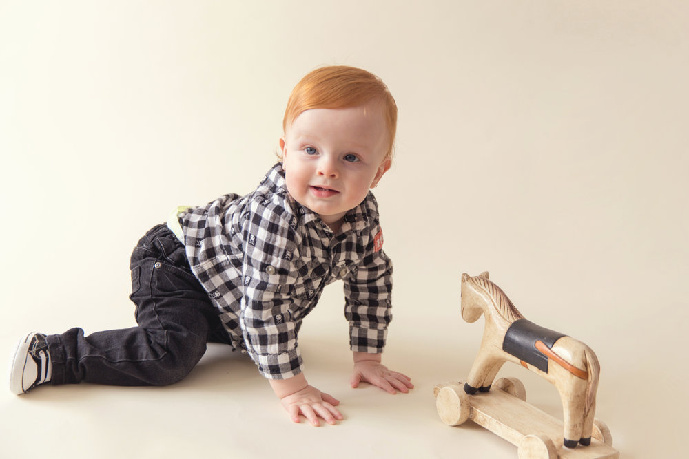 Boy and his wooden horse. Redheads rock! Airdrie and Calgary Children's Photographer.