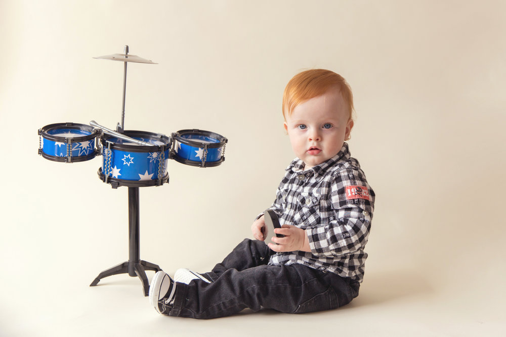 Little redhead boy with a drum set.  Ed Sheeran watch out. Calgary photographer.