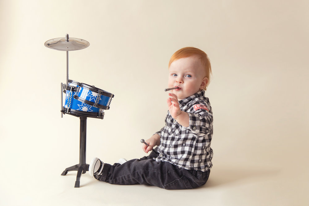 Little boy is playing drums. Airdrie, Calgary, Alberta child photographer.