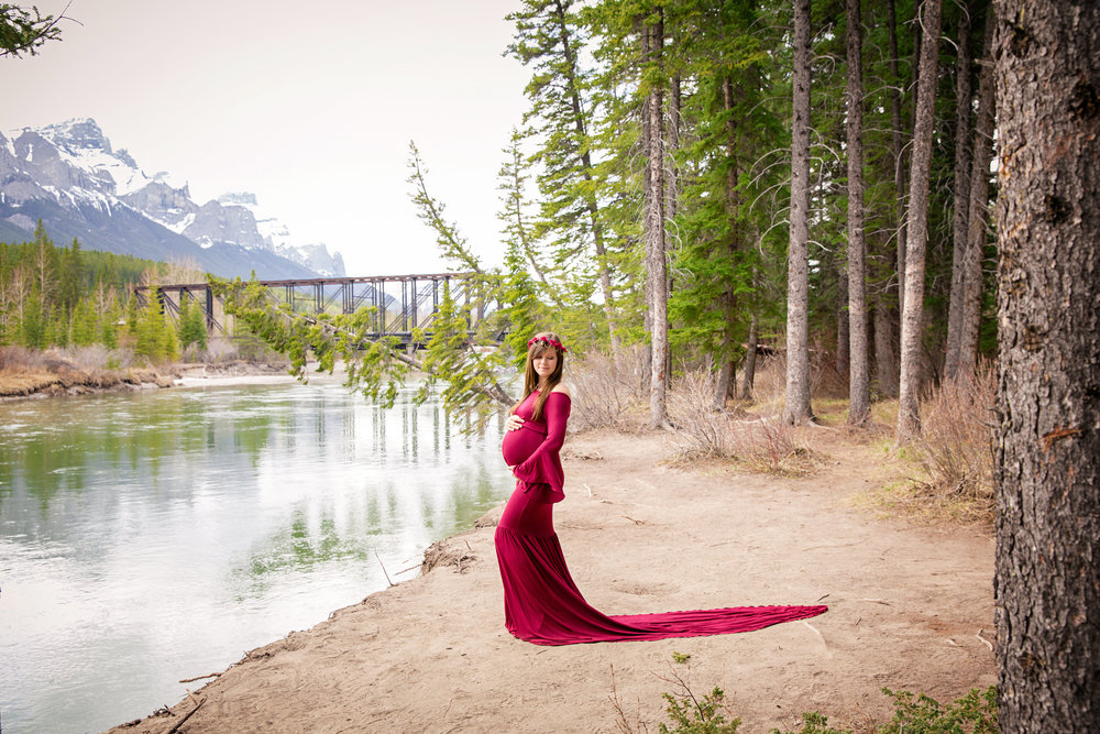 Photosession in the mountains with a beautiful mom-to-be in a red gorgeous gown. Canmore and Kananaskis maternity photographer. Milashka Photography
